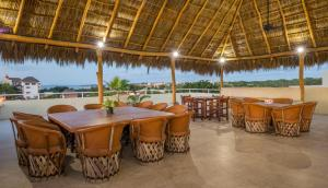 A restaurant or other place to eat at Punto Mita Suites