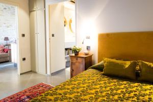 Un ou plusieurs lits dans un hébergement de l'établissement Domaine de Labarthe Maison d'hotes