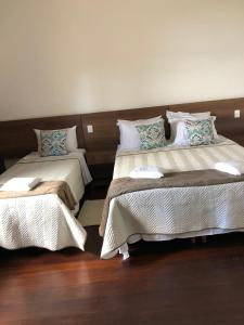 A bed or beds in a room at Pousada Recanto do Turvo