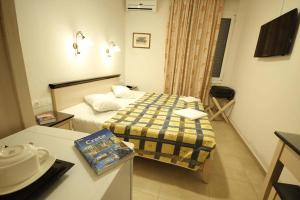 A bed or beds in a room at Mirabello Hotel
