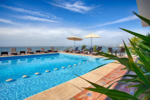 The swimming pool at or close to The Paramar Beachfront Boutique Hotel With Breakfast Included - Downtown Malecon