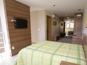 A bed or beds in a room at Duplex Apto Setor Hoteleiro Norte