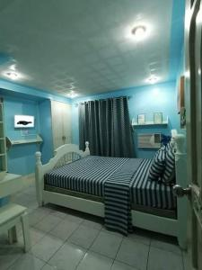 A bed or beds in a room at Fabuluz Luxury at Princess Place