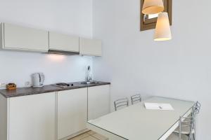 A kitchen or kitchenette at Lithos by Spyros & Flora