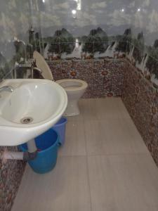 A bathroom at Aguiar Guest House