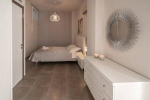 A bed or beds in a room at Ioanna View Luxury Apartment