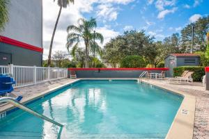 The swimming pool at or near OYO Townhouse Orlando West