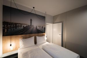 Ein Bett oder Betten in einem Zimmer der Unterkunft Lakeside77