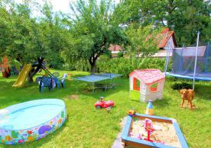 Children's play area at Wohlfühlferienhaus Berlin- Wellness, Pool beheizt, Sauna, Spielplatz