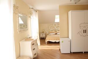 Кровать или кровати в номере Гостиница Геркулес