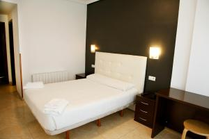 A bed or beds in a room at Hotel Artxanda