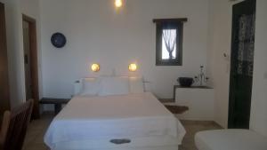 Ένα ή περισσότερα κρεβάτια σε δωμάτιο στο Απέραντο