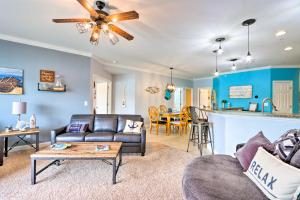 A seating area at Lakefront Camdenton Condo with Deck, Shared Pool
