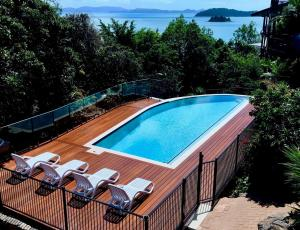 A view of the pool at Casuarina Cove 13 on Hamilton Island by HamoRent or nearby