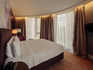 Кровать или кровати в номере DoubleTree by Hilton Moscow – Marina