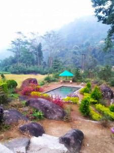 A view of the pool at CHETNA FARMs Jhepi or nearby