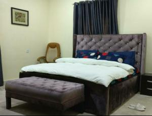 A bed or beds in a room at The Gramophone Abuja