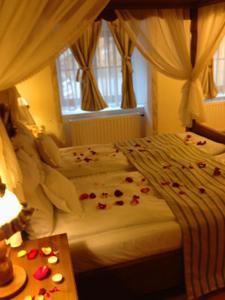 Een bed of bedden in een kamer bij Hotel Villa Franca