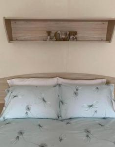 A bed or beds in a room at Home from Home Caravan Hire Havens Thorpe Park Cleethorpes