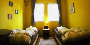 A bed or beds in a room at Bellscabin Guesthouse