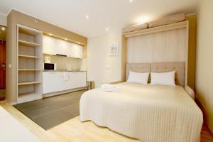 Кровать или кровати в номере Апарт-отель Вертикаль