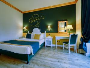 Letto o letti in una camera di Gardaland Hotel