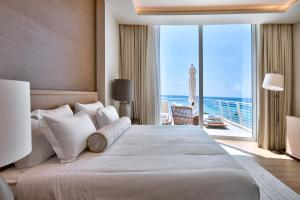 A bed or beds in a room at Radisson Blu Resort & Spa, Malta Golden Sands