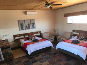 A bed or beds in a room at Aloegrove Safari Lodge