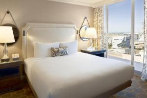 A bed or beds in a room at Fairmont Dallas