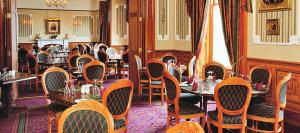 A restaurant or other place to eat at The Grand Hotel