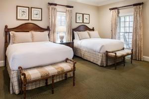 A bed or beds in a room at Barnsley Resort