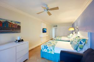 A bed or beds in a room at Coconut Bay Beach Resort & Spa All Inclusive
