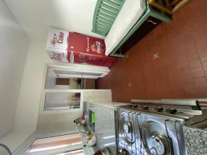 A kitchen or kitchenette at departamento amplio excelente ubicacion