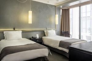 Cama o camas de una habitación en Hotel Fundador