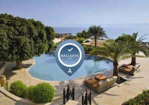 A view of the pool at Mövenpick Resort & Spa Dead Sea or nearby