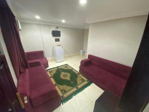 Uma área de estar em فندق النهضة Al Nahda Hotel