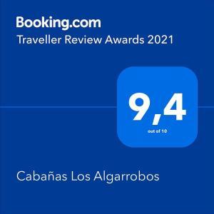 Un certificado, premio, cartel u otro documento en Cabañas Los Algarrobos