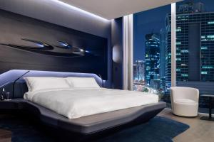 A bed or beds in a room at ME Dubai by Meliá
