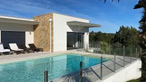 The swimming pool at or near Cecile's Villa