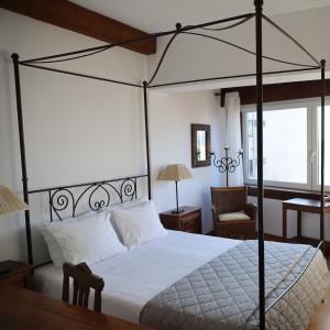 Uma cama ou camas num quarto em Hotel Portofoz