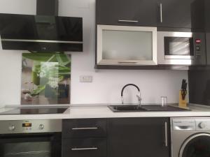 Una cocina o zona de cocina en Aloha Apartament Sun&Beach