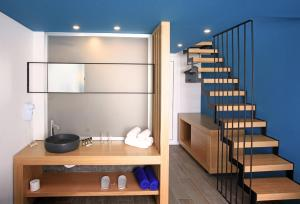 A kitchen or kitchenette at Meropi Hotel & Apartments