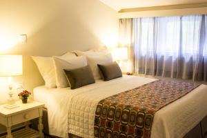 Cama ou camas em um quarto em Recanto Da Paz Hotel Fazenda