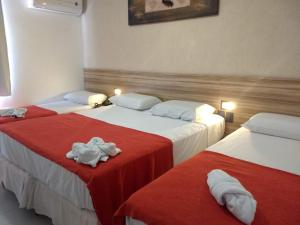 A bed or beds in a room at Pousada Aquarela Do Brasil