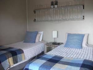 A bed or beds in a room at Meerkat Manor