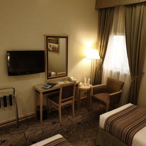 Uma TV ou centro de entretenimento em Al Massa Hotel Makkah