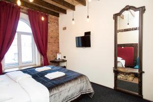 Кровать или кровати в номере Bronza Hotel