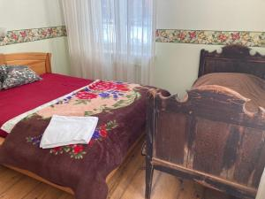 A bed or beds in a room at Mīlmaņi