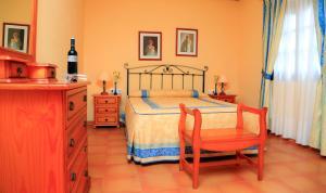 Een bed of bedden in een kamer bij Vip Villas - Caleta Dorada