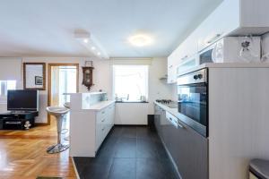 A kitchen or kitchenette at Villa Dubrovnik Platinum A Beautiful 5 Bedroom Villa Sea Views Gym Sauna Indoor Pool